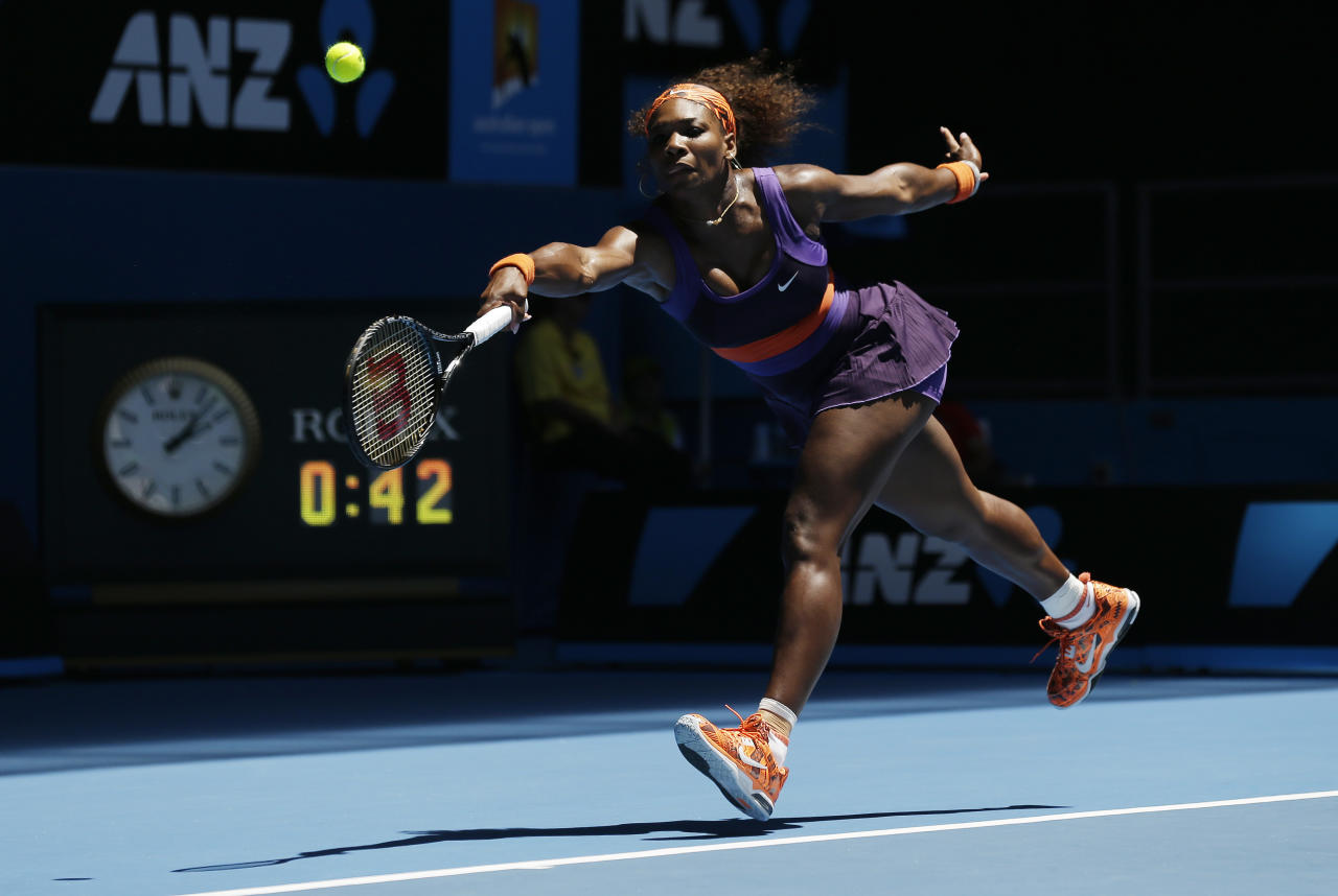 Serena Williams of the US stretches for forehand return to mRomania's Edina Gallovits-Hall during their first round match at the Australian Open tennis championship in Melbourne, Australia, Tuesday, Jan. 15, 2013. (AP Photo/Rob Griffith)