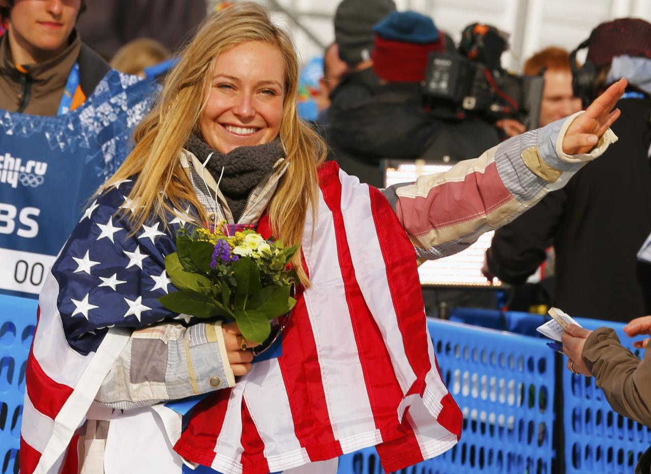 Jamie Anderson of the U.S celebrates after the women's snowboard slopestyle finals event at the 2014 Sochi Winter Olympics in Rosa Khutor, February 9, 2014. Anderson laid down the best run of the day to clinch the first Olympic gold medal in women's snowboarding slopestyle at the Sochi Games on Sunday. REUTERS/Mike Blake (RUSSIA - Tags: SPORT OLYMPICS SPORT SNOWBOARDING)