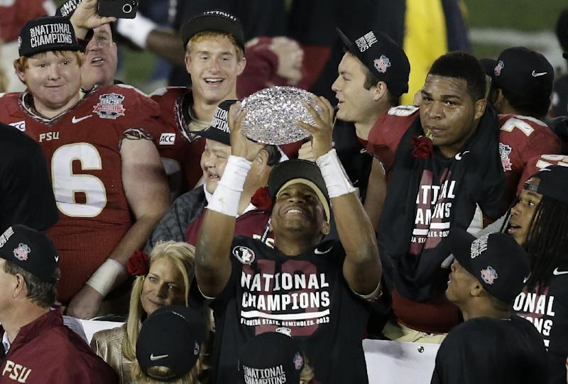 Florida State's Jameis Winston celebrates with The Coaches' Trophy after the NCAA BCS National Championship college football game against Auburn Monday, Jan. 6, 2014, in Pasadena, Calif. Florida State won 34-31