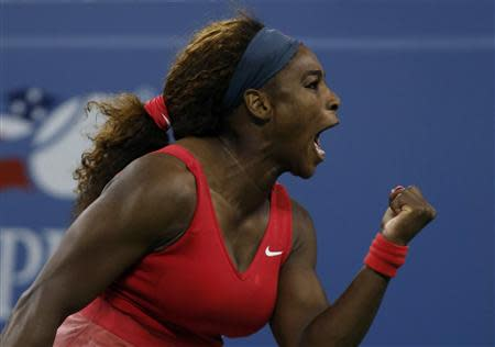 Serena Williams of the U.S. celebrates a point against Victoria Azarenka of Belarus during their women's singles final match at the U.S. Open tennis championships in New York September 8, 2013. REUTERS/Mike Segar