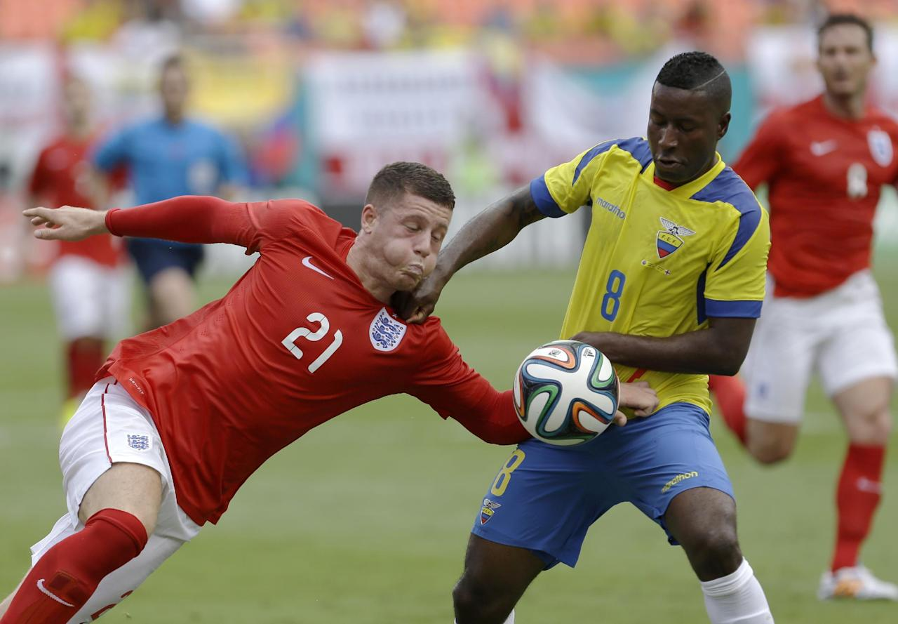 England's Ross Barkley (21) battles Ecuador's Edison Mendez (8) for control of the ball in the second half of a friendly soccer match in Miami Gardens, Fla., Wednesday, June 4, 2014. The game ended a 2-2 tie. (AP Photo/Alan Diaz)