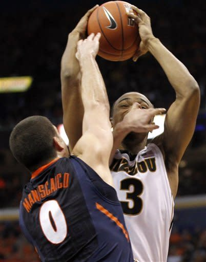 Missouri's Matt Pressey (3) is fouled on his way to the basket by Illinois' Sam Maniscalco during the second half of an NCAA college basketball game Thursday, Dec. 22, 2011, in St. Louis. Missouri won 78-74. (AP Photo/Jeff Roberson)