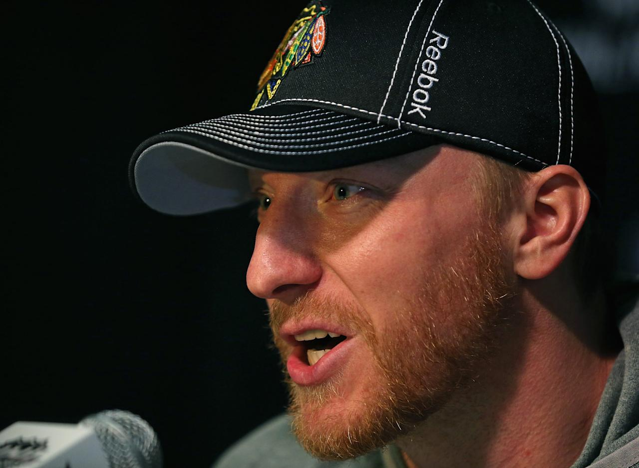 CHICAGO, IL - JUNE 11:  Marian Hossa #81 of the Chicago Blackhawks answers questions during the 2013 NHL Stanley Cup media day at the United Center on June 11, 2013 in Chicago, Illinois.  (Photo by Jonathan Daniel/Getty Images)