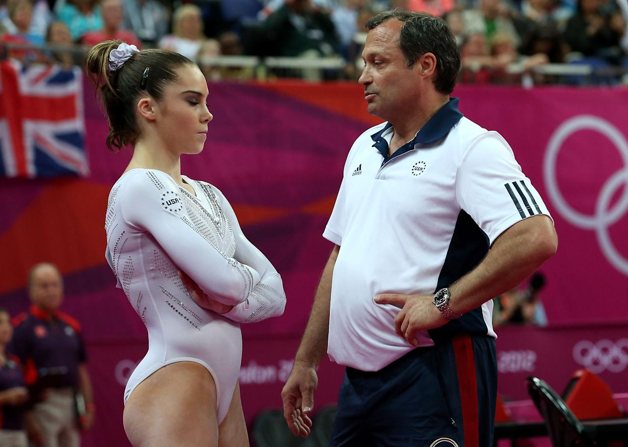 LONDON, ENGLAND - AUGUST 05:  (L-R) Mc Kayla Maroney of the United States looks on as she is consoled by coach Yin Alvarez after she fell on a dismount while competing in the Artistic Gymnastics Women's Vault Final on Day 9 of the London 2012 Olympic Games at North Greenwich Arena on August 5, 2012 in London, England.  (Photo by Ronald Martinez/Getty Images)