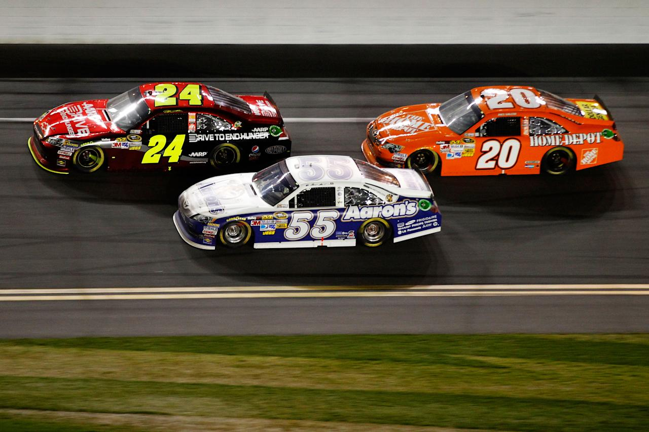DAYTONA BEACH, FL - FEBRUARY 27:  Jeff Gordon, driver of the #24 Drive to End Hunger Chevrolet, Mark Martin, driver of the #55 Aaron's Toyota, and Joey Logano, driver of the #20 The Home Depot Toyota, race during the NASCAR Sprint Cup Series Daytona 500 at Daytona International Speedway on February 27, 2012 in Daytona Beach, Florida.  (Photo by Streeter Lecka/Getty Images)