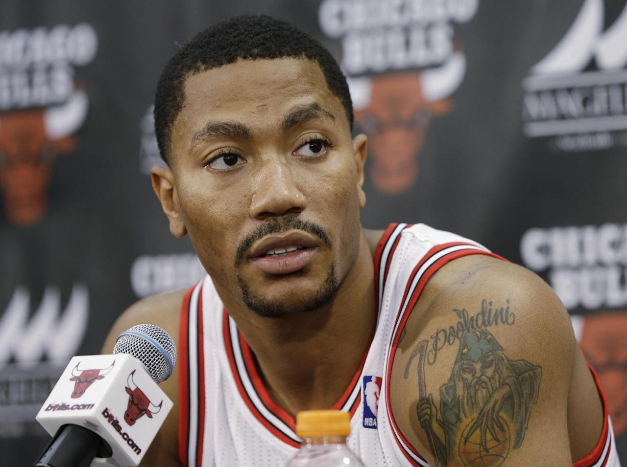 Chicago Bulls guard Derrick Rose speaks during a news conference at the NBA basketball team's media day Friday, Sept. 27, 2013, in Deerfield, Ill. Rose missed last season after tearing an ACL in a playoff game in 2012. (AP Photo/Nam Y. Huh)