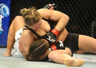 Champion Ronda Rousey (top) defeated Liz Carmouche at UFC 157 in the first women's fight in UFC history. (Jayne Kamin-Oncea-USA TODAY Sports)