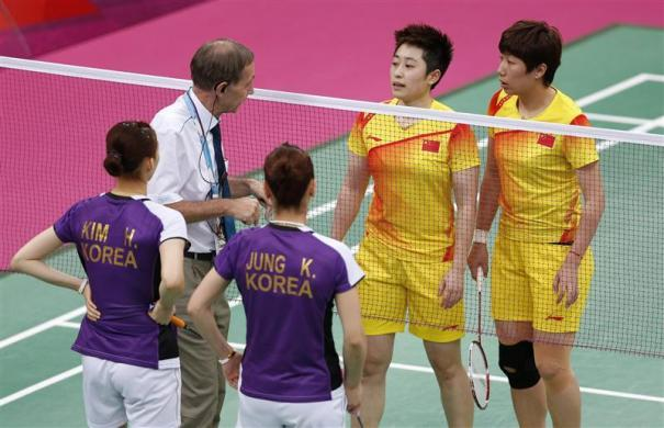 "The World Badminton Federation charged eight female players with misconduct on August 1, 2012 after four Olympic doubles teams had attempted to ""throw"" matches to secure a more favorable draw later in the tournament. Tournament referee Torsten Berg (2nd L) speaks to players from China and South Korea during their women's doubles group play stage Group A badminton match during the London 2012 Olympic Games at the Wembley Arena July 31, 2012."