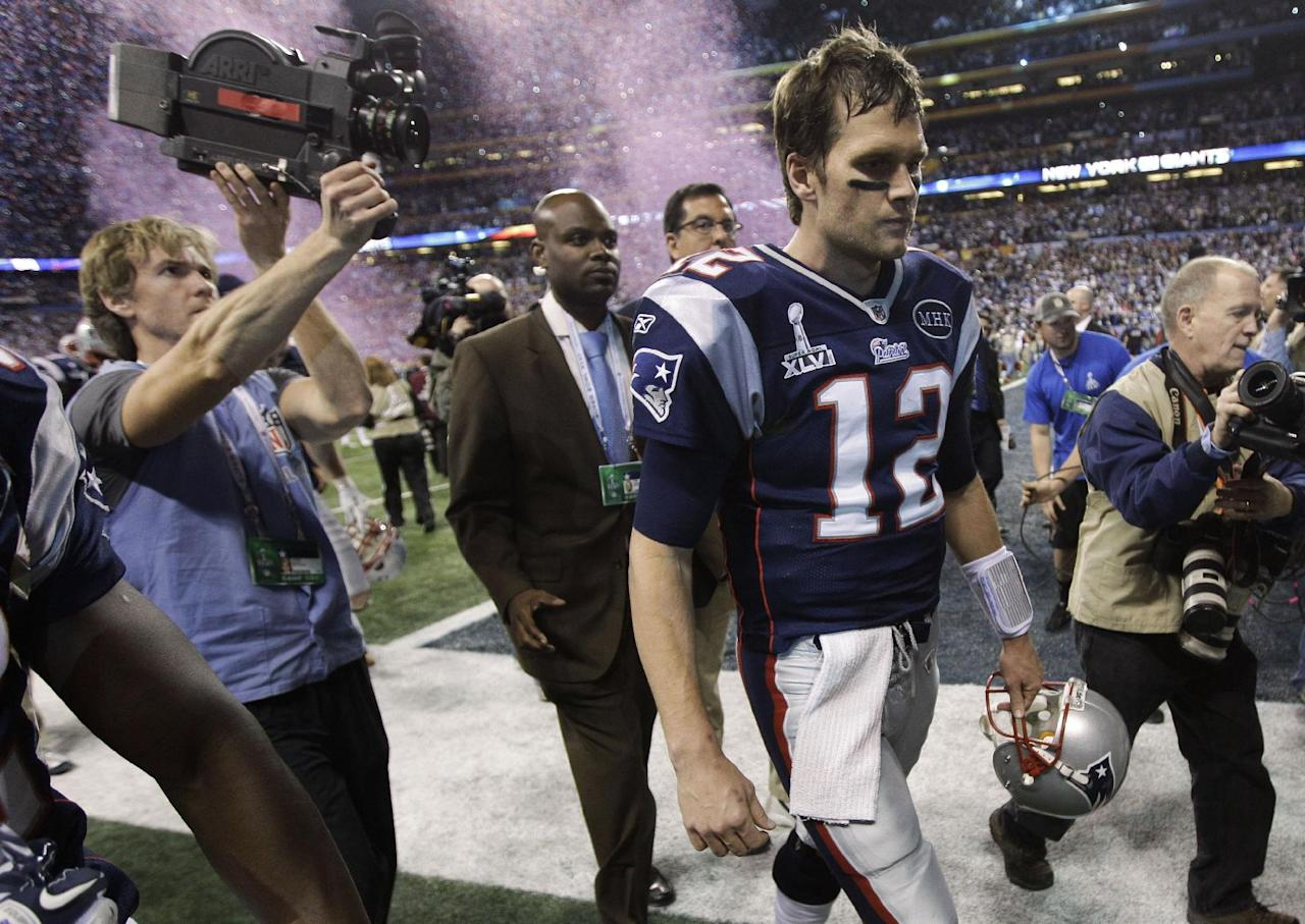 New England Patriots quarterback Tom Brady walks off the field after the Patriots' 21-17 loss to the New York Giants in the NFL Super Bowl XLVI football game, Sunday, Feb. 5, 2012, in Indianapolis. (AP Photo/Paul Sancya)