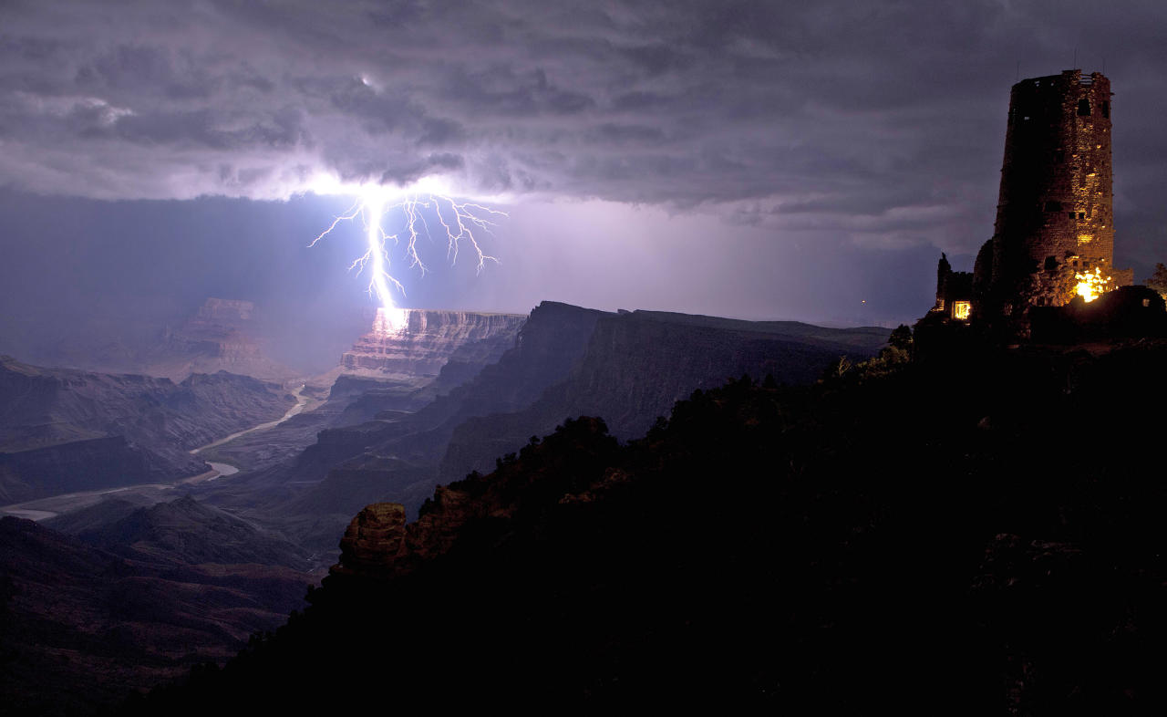 **MANDATORY BYLINE** PIC BY TRAVIS ROE / U.S. DEPT OF THE INTERIOR / CATERS NEWS - (PICTURED: LIGHTNING STRIKING GRAND CANYON) - This is the incredible moment a fierce lightning bolt crashed against the Grand Canyon illuminating the steep canyon walls. Shrouded in darkness, the breath-taking landscape was shocked into life as mother nature sent the bolt storming down to Earth. As it cracked against the rocks the bright blue bolt illuminated the South Rim of the canyon, considered one of the Seven Natural Wonders of the World. With just the Desert View Watchtower in the foreground, the lightning was perfectly framed by the canyon which is located in Arizona, USA. The once-in-a-lifetime shot, captured by photographer Travis Roe, was taken last year but has only just surfaced after he submitted the image to the U.S. Department of the Interior. The DOI, the government agency tasked with protecting US land, water and wildlife, runs an annual photo contest called Share the Experience. SEE CATERS COPY