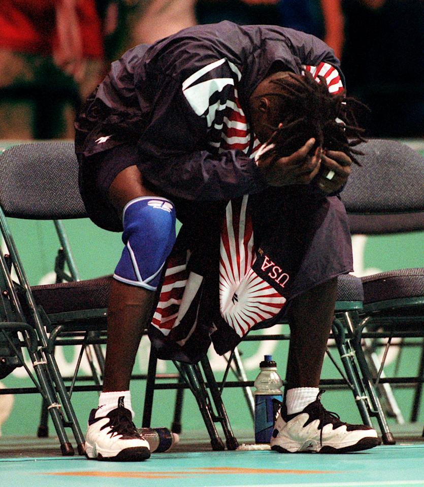 U.S. handball player Darrick Heath displays his dejection after the team lost to Switzerland at the Centennial Summer Olympics in Atlanta on Monday, July 29, 1996.  (AP Photo/John Bazemore)