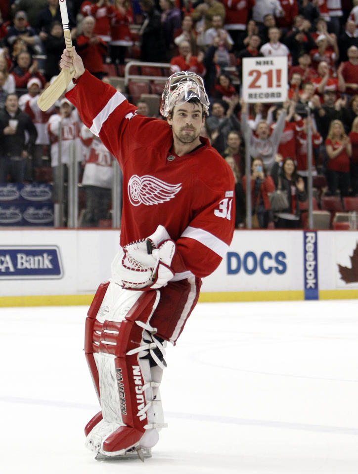 Detroit Red Wings goalie Joey MacDonald celebrates the Red Wings' 3-1 win over the Dallas Stars in an NHL hockey game in Detroit, Tuesday, Feb. 14, 2012. Detroit set an NHL record with 21 consecutive home victories. (AP Photo/Paul Sancya)