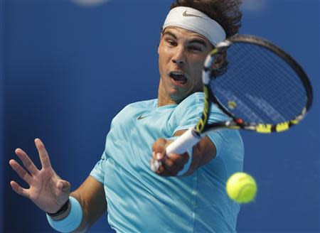 Rafael Nadal of Spain returns a shot during his quarterfinal match against Fabio Fognini of Italy in the China Open tennis tournament in Beijing