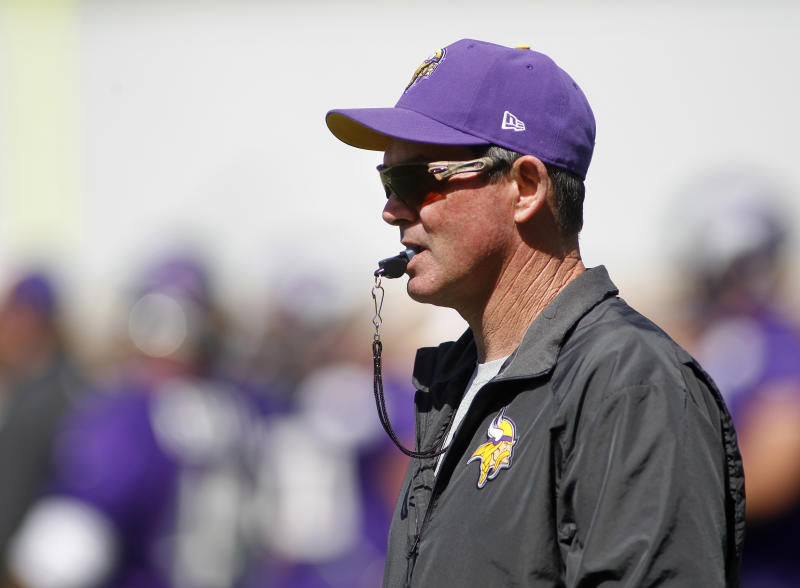 Minnesota Vikings head coach Mike Zimmer watches at an NFL organized team activity at the Vikings football practice facility in Eden Prairie, Minn., Thursday, May  29, 2014