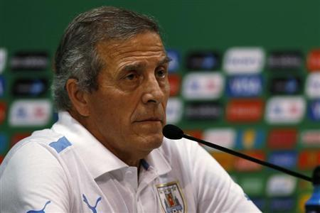 Uruguay's soccer team head coach Oscar Tabarez listens to a question during a news conference after a training session, ahead of their Confederations Cup soccer match against Tahiti on Sunday at the Arena Pernambuco Stadium, in Recife June 22, 2013. REUTERS/Ivan Alvarado
