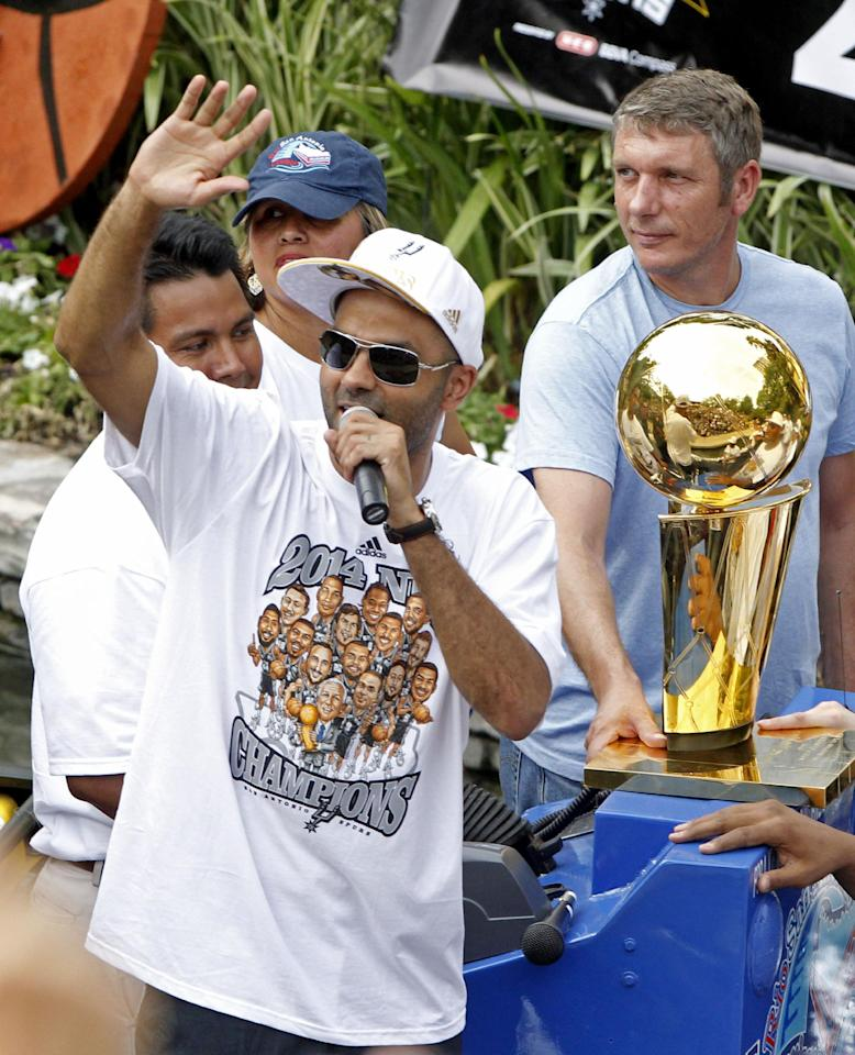 San Antonio's Tony Parker waves to the crowd during the Spurs' parade and celebration of their 5th NBA Championship in San Antonio, Texas, Weds.,  June 18, 2014.  (AP Photo/Michael Thomas)