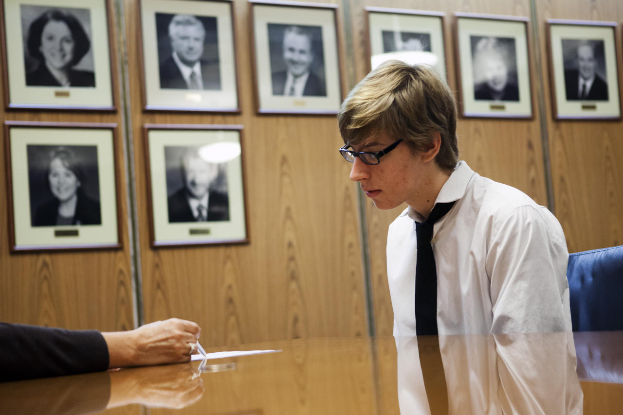 Student Miles Spencer, 17, receives feedback on his resume during an interview as part of work readiness training at the Los Angeles Area Chamber of Commerce in Los Angeles, California April 14, 2012. If the students performed well in their mock interviews with the volunteers, they will be eligible to interview for jobs with the L.A. County Bar Association. Picture taken April 14, 2012.   REUTERS/Patrick T. Fallon (UNITED STATES - Tags: EDUCATION BUSINESS EMPLOYMENT)