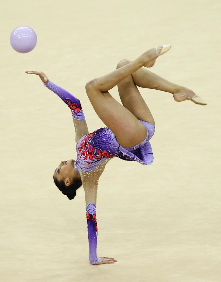 LONDON, ENGLAND - JANUARY 16:  Djamila Rakhmatova of Uzbekistan in action in the Individual All-Around during the FIG Rhythmic Gymnastics Olympic Qualification round  at North Greenwich Arena on January 16, 2012 in London, England.  (Photo by Ian Walton/Getty Images)