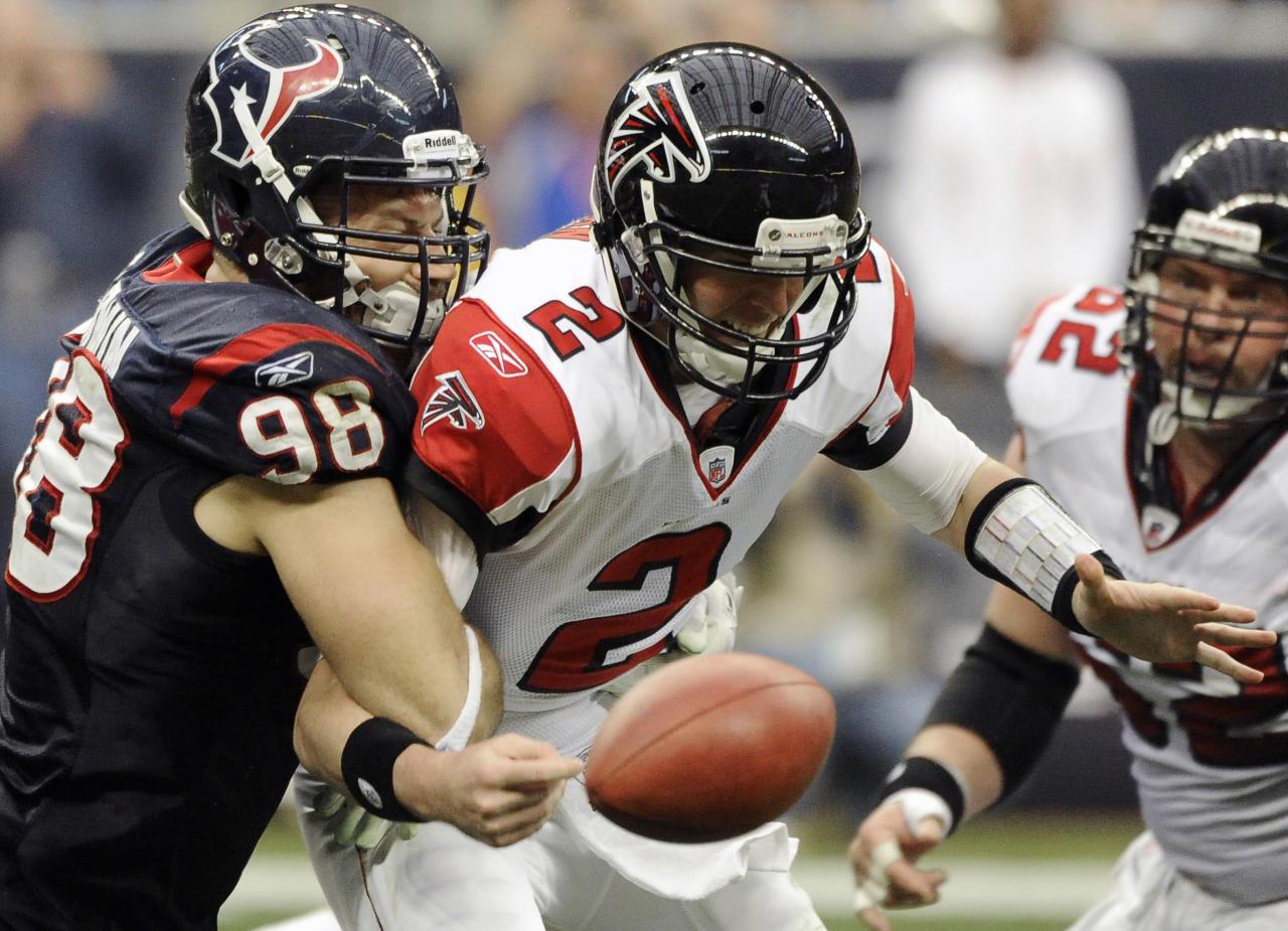 Houston Texans outside linebacker Connor Barwin (98) forces a fumble on Atlanta Falcons quarterback Matt Ryan (2) in the third quarter of an NFL football game on Sunday, Dec. 4, 2011, in Houston. The Texans recovery of the fumble was negated due to a defensive holding call. (AP Photo/Dave Einsel)