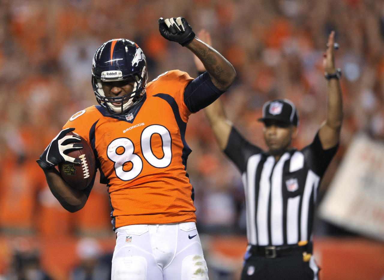 Denver Broncos tight end Julius Thomas (80) celebrates his touchdown against the Baltimore Ravens during the first half of an NFL football game, Thursday, Sept. 5, 2013, in Denver. (AP Photo/Jack Dempsey)