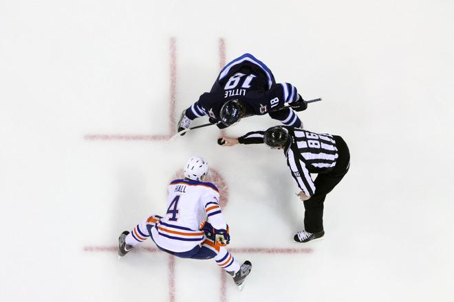 WINNIPEG, CANADA - FEBRUARY 27:  Taylor Hall #4 of the Edmonton Oilers gets set for a first-period faceoff against Bryan Little #18 of the Winnipeg Jets at the MTS Centre on February 27, 2012 in Winnipeg, Manitoba, Canada. (Photo by Jonathan Kozub/NHLI via Getty Images)