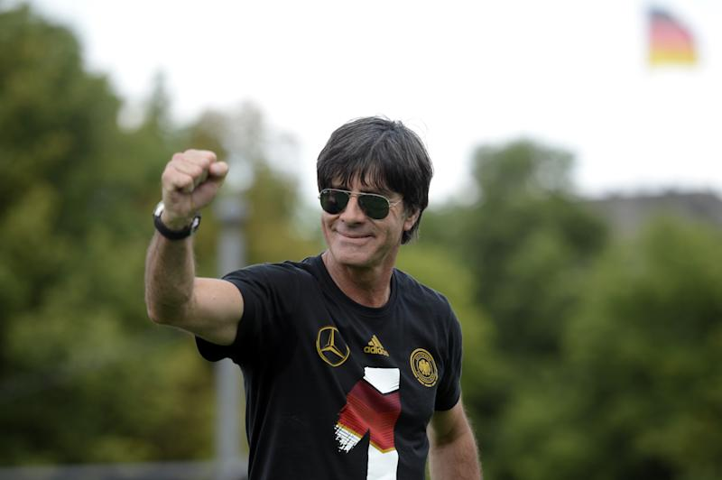 Germany's coach Joachim Loew celebrate their FIFA World Cup title at Berlin's landmark Brandenburg Gate on July 13, 2014