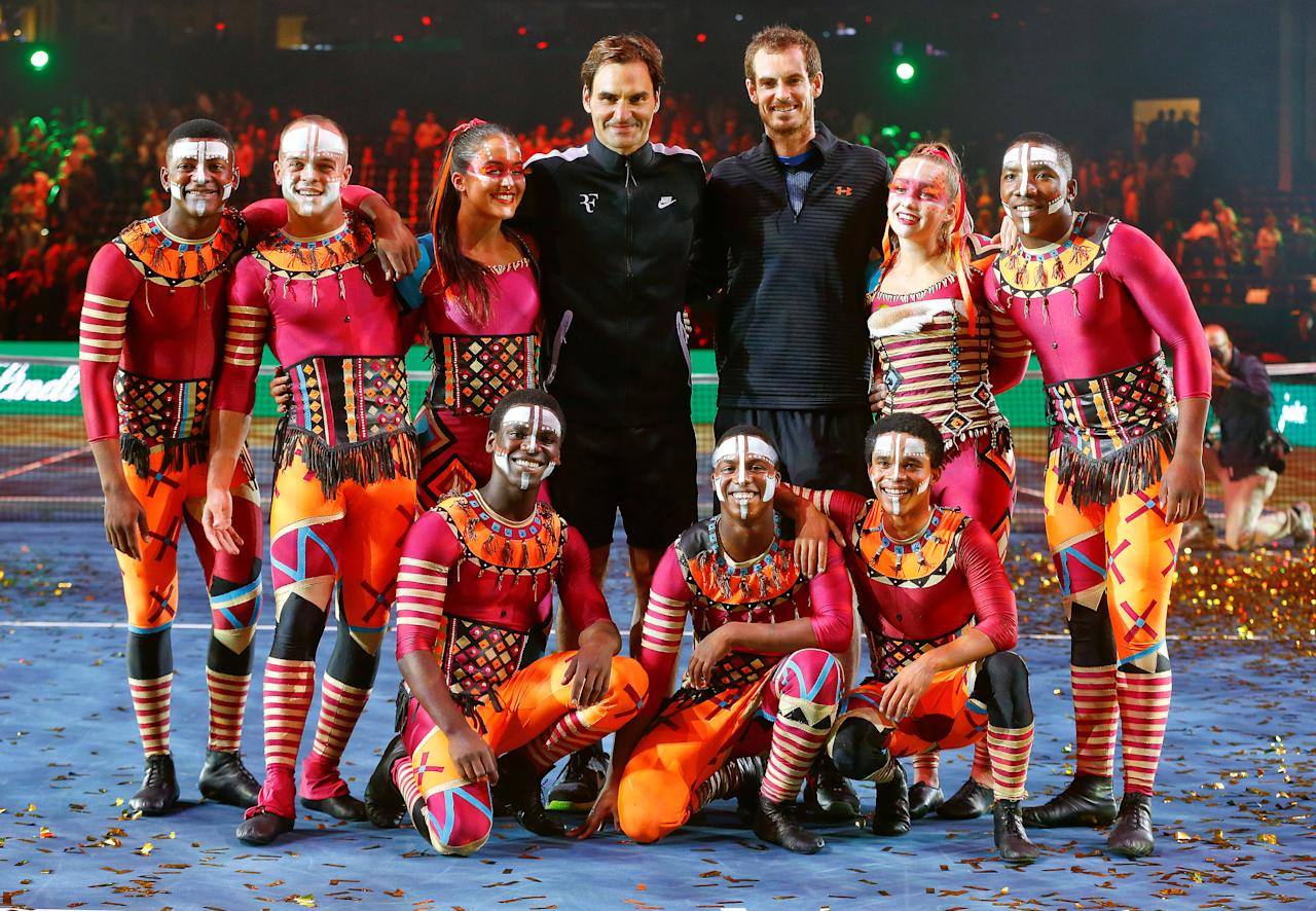 Tennis - Match for Africa 3 - Federer vs Murray - Zurich, Switzerland - 10/04/2017 -  Andy Murray of Britain and Switzerland's Roger Federer pose with members of the South African Zip Zap Circus after the Match for Africa 3 benefit tennis match. REUTERS/Arnd Wiegmann