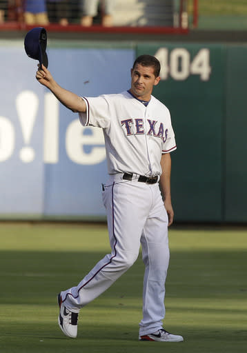Texas hits leader Young retires with Rangers