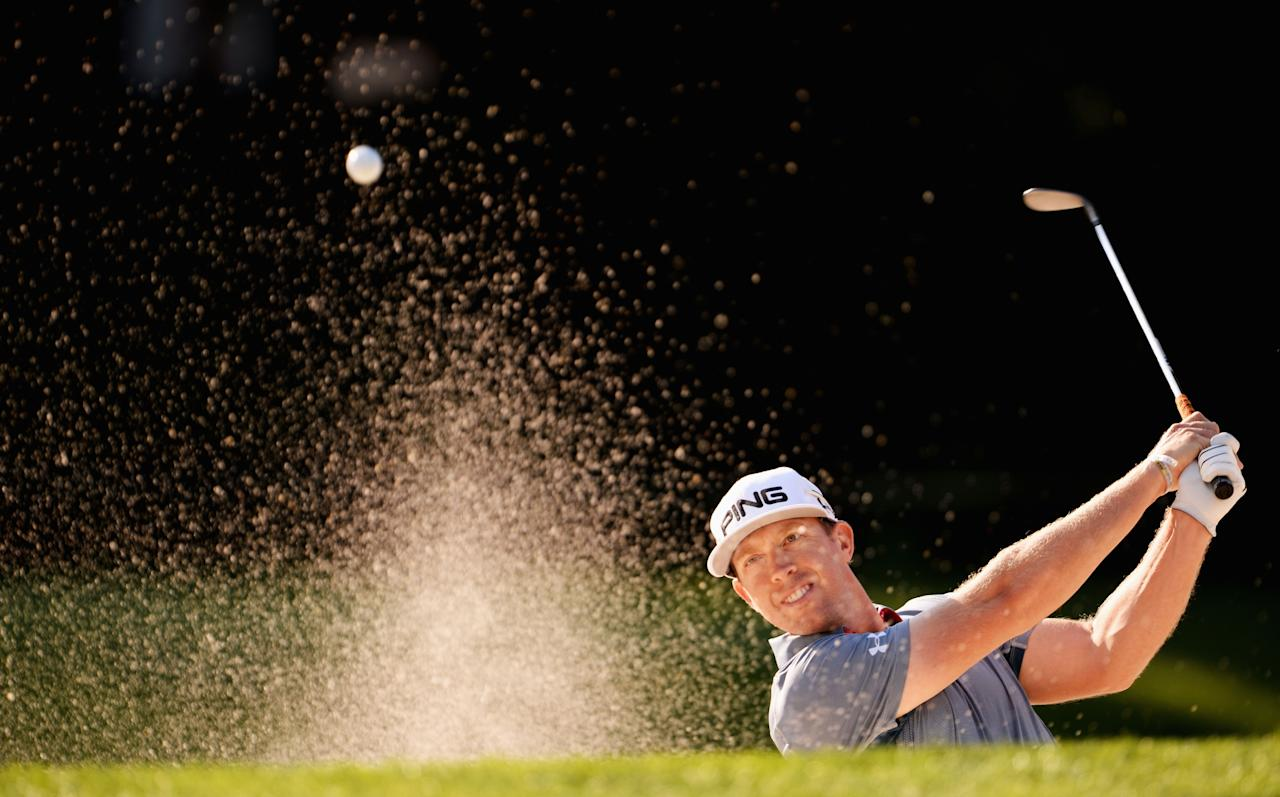 ROCHESTER, NY - AUGUST 07: Hunter Mahan of the United States players a bunker shot during a practice round prior to the start of the 95th PGA Championship at Oak Hill Country Club on August 7, 2013 in Rochester, New York. (Photo by Stuart Franklin/Getty Images)