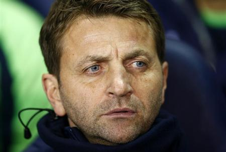 Tottenham Hotspur caretaker manager Tim Sherwood watches their English League Cup soccer match against West Ham United at White Hart Lane, London