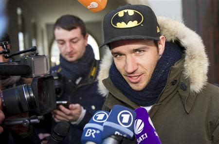 German alpine skier Felix Neureuther talks to the media after leaving a medical check with his doctor Hans-Wilhelm Mueller-Wohlfahrt in Munich