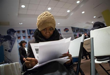 A woman fills out paperwork at a job training and resource fair at Coney Island in New York