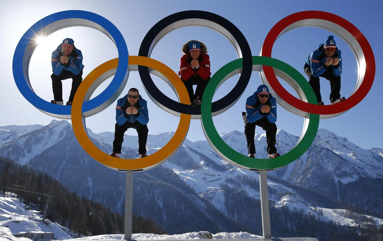 Austrian alpine skiers (L-R) Georg Streitberger, Klaus Kroell, Max Franz, Joachim Puchner and Romed Baumann pose for a photograph in the Olympic rings at the Olympic athletes mountain village in Rosa Khutor, near Sochi February 4, 2014. Sochi will host the 2014 Winter Olympic Games from February 7 to 23. REUTERS/Kai Pfaffenbach (RUSSIA - Tags: SPORT SKIING OLYMPICS TPX IMAGES OF THE DAY)