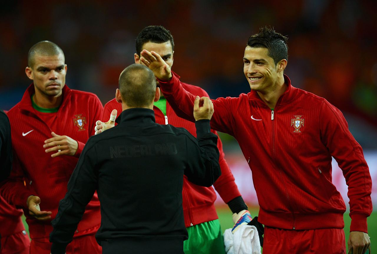 KHARKOV, UKRAINE - JUNE 17:  Cristiano Ronaldo (R) of Portugal greets Wesley Sneijder of Netherlands during the UEFA EURO 2012 group B match between Portugal and Netherlands at Metalist Stadium on June 17, 2012 in Kharkov, Ukraine.  (Photo by Lars Baron/Getty Images)