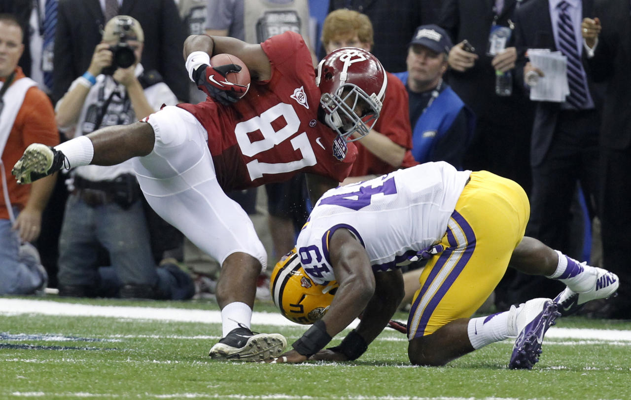 Alabama's Chris Underwood (87) is tackled by LSU's Barkevious Mingo on a fake punt during the first half of the BCS National Championship college football game Monday, Jan. 9, 2012, in New Orleans. Alabama got a first down on the play. (AP Photo/Gerald Herbert)