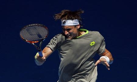 David Ferrer of Spain hits a return to Jeremy Chardy of France during their men's singles match at the Australian Open 2014 tennis tournament in Melbourne