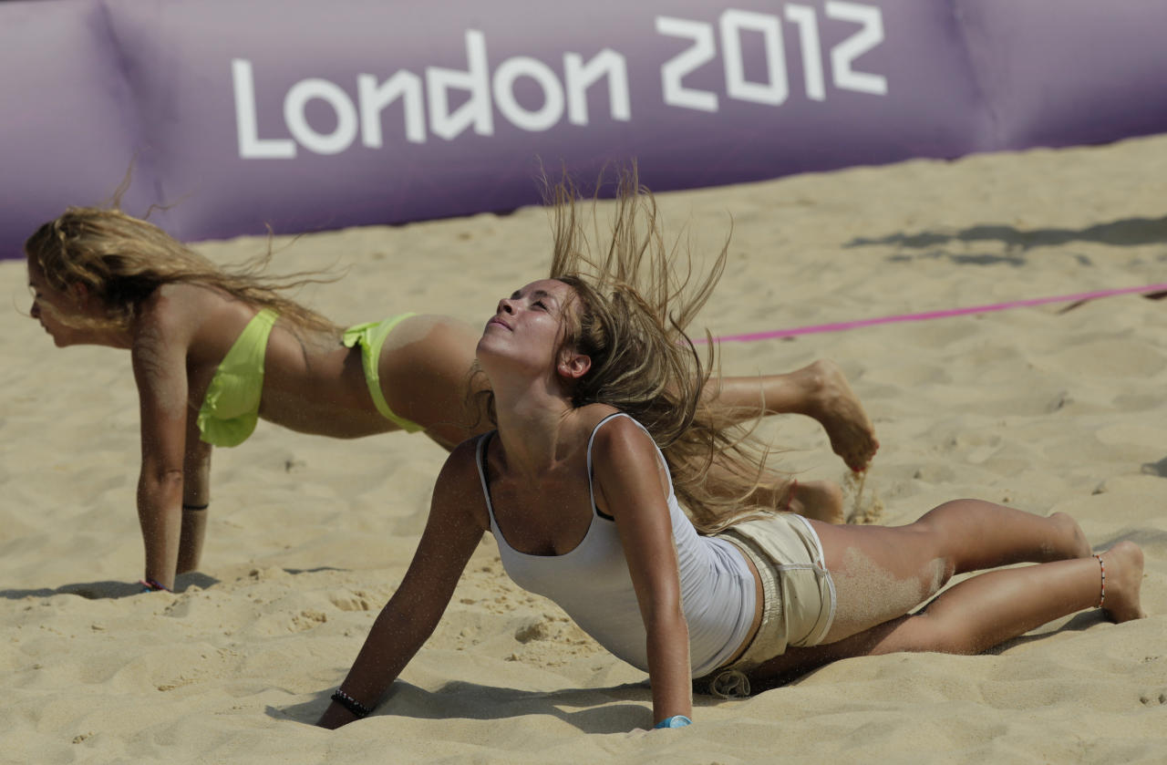 Dancers rehearse prior to the start of the Beach Volleyball competition at the 2012 Summer Olympics, Wednesday, July 25, 2012, in London. (AP Photo/Dave Martin)