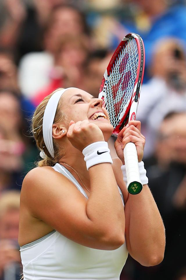 LONDON, ENGLAND - JULY 02: Sabine Lisicki of Germany celebrates match point during the Ladies' Singles quarter-final match against Kaia Kanepi of Estonia on day eight of the Wimbledon Lawn Tennis Championships at the All England Lawn Tennis and Croquet Club at Wimbledon on July 2, 2013 in London, England. (Photo by Julian Finney/Getty Images)