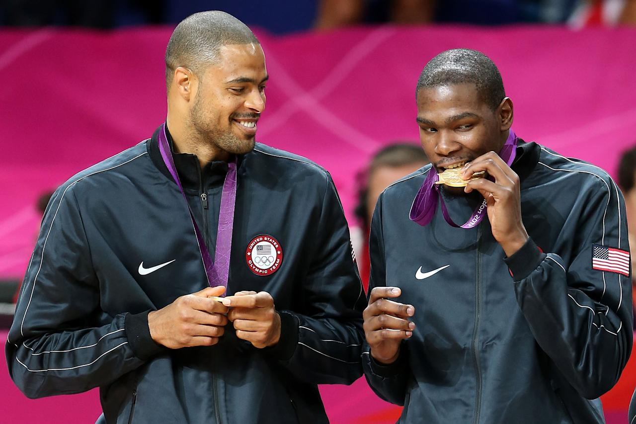 LONDON, ENGLAND - AUGUST 12:  Gold medallists Tyson Chandler #4 of the United States and Kevin Durant #5 of the United States celebrate on the podium during the medal ceremony for the Men's Basketball on Day 16 of the London 2012 Olympics Games at North Greenwich Arena on August 12, 2012 in London, England.  (Photo by Streeter Lecka/Getty Images)