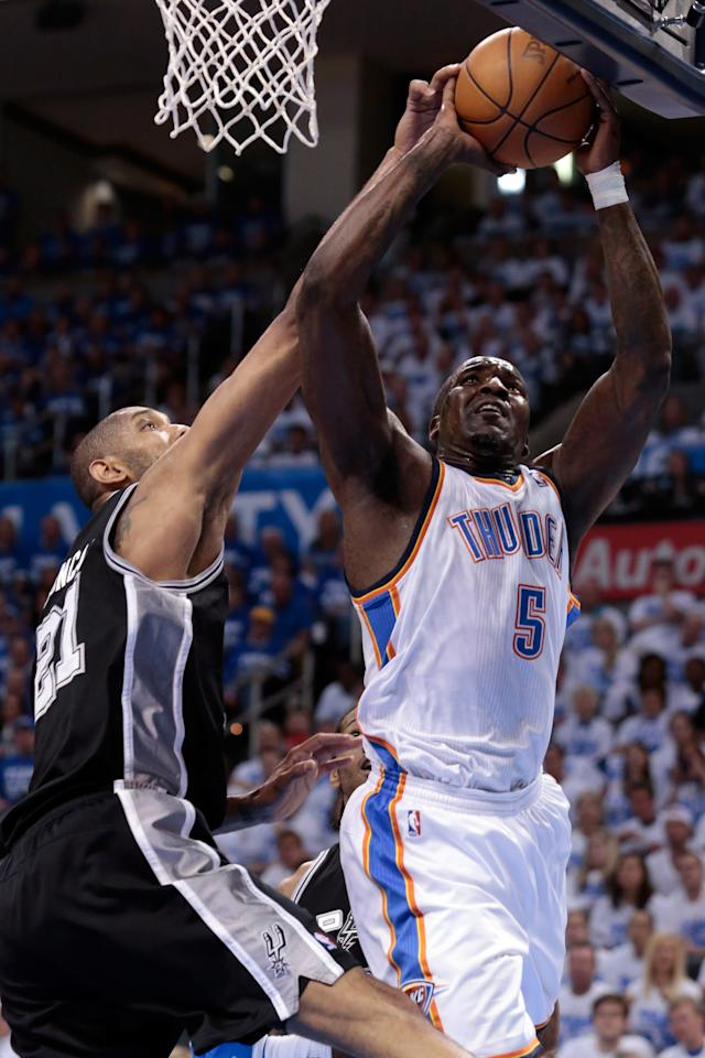 OKLAHOMA CITY, OK - JUNE 02:  Kendrick Perkins #5 of the Oklahoma City Thunder goes up for a shot against Tim Duncan #21 of the San Antonio Spurs in the first quarter in Game Four of the Western Conference Finals of the 2012 NBA Playoffs at Chesapeake Energy Arena on June 2, 2012 in Oklahoma City, Oklahoma. NOTE TO USER: User expressly acknowledges and agrees that, by downloading and or using this photograph, User is consenting to the terms and conditions of the Getty Images License Agreement.  (Photo by Brett Deering/Getty Images)