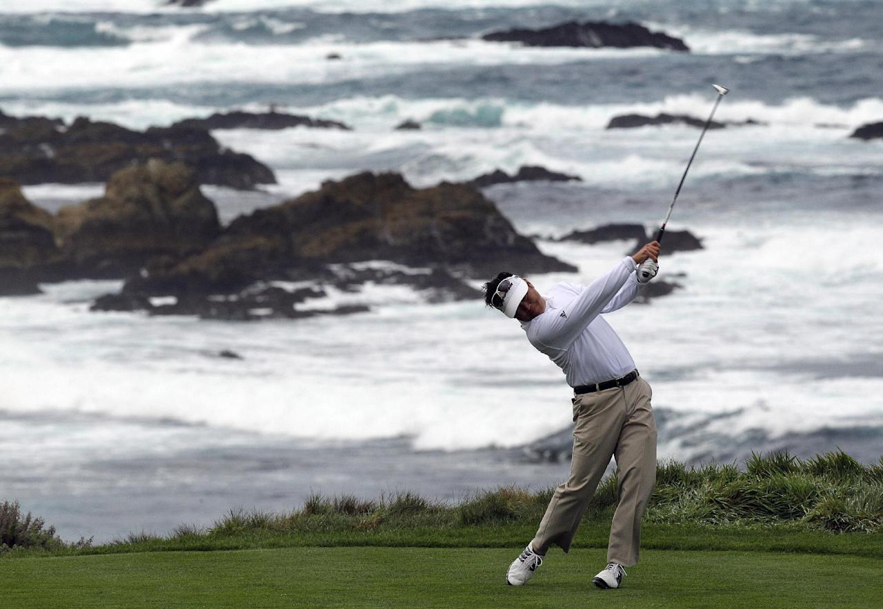 Michael Wi hits off the fourth tee of the Spyglass Hill golf course during the third round of the AT&T Pebble Beach National Pro-Am golf tournament Saturday, Feb. 11, 2012, in Pebble Beach, Calif. (AP Photo/Ben Margot)