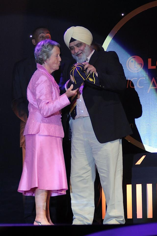 [ICCWWC2013] BANGALORE, INDIA - OCTOBER 06:  Rachel Heyhoe Flint receives the hall of fame award by Bishan singh Bedi during the ICC Annual Awards at the Grand Castle, on October 6, 2010 in Bangalore, India.  (Photo by Pal Pillai/Getty Images)