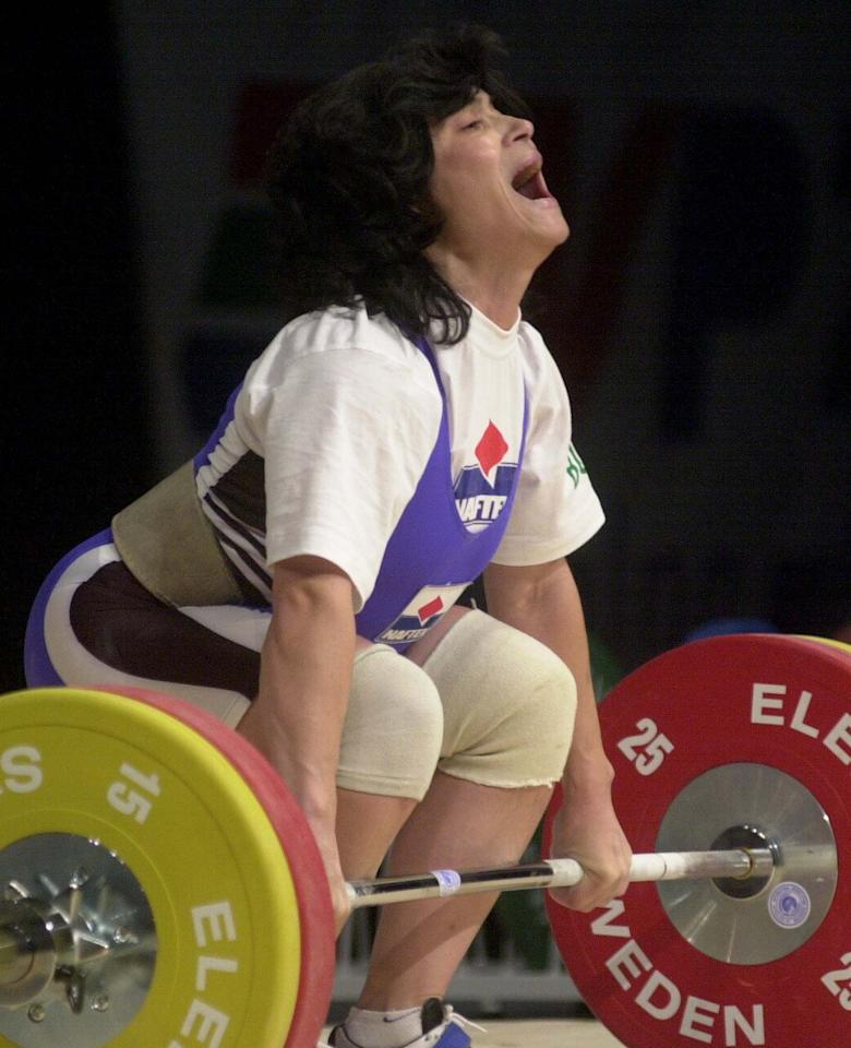 Bulgarian weightlifer Izabela Dragneva won the gold medal at the 2000 Sydney Games, but she later lost it when she tested positive for a banned diuretic substance. (AP Photo/Alik Keplicz)