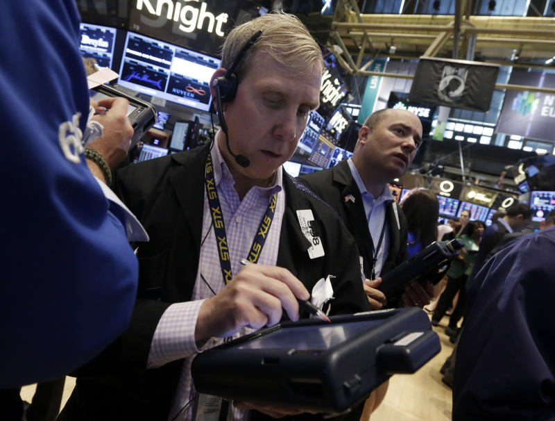 FILE - In this Friday, May 31, 2013 file photo, trader Richard Cohen, center, works on the floor of the New York Stock Exchange. Stock markets in Europe recovered their poise Thursday June 6, 2013 despite a big retreat earlier in Asia earlier and a glitch that temporarily affected several major exchanges.  (AP Photo/Richard Drew, File)