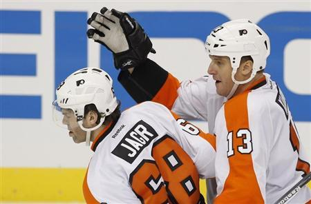 Philadelphia Flyers Jagr is congratulated by teammate Kubina after he scored the game winning goal against the Pittsburgh Penguins during the third period of Game 2 of their NHL Eastern Conference quarter-final hockey game in Pittsburgh