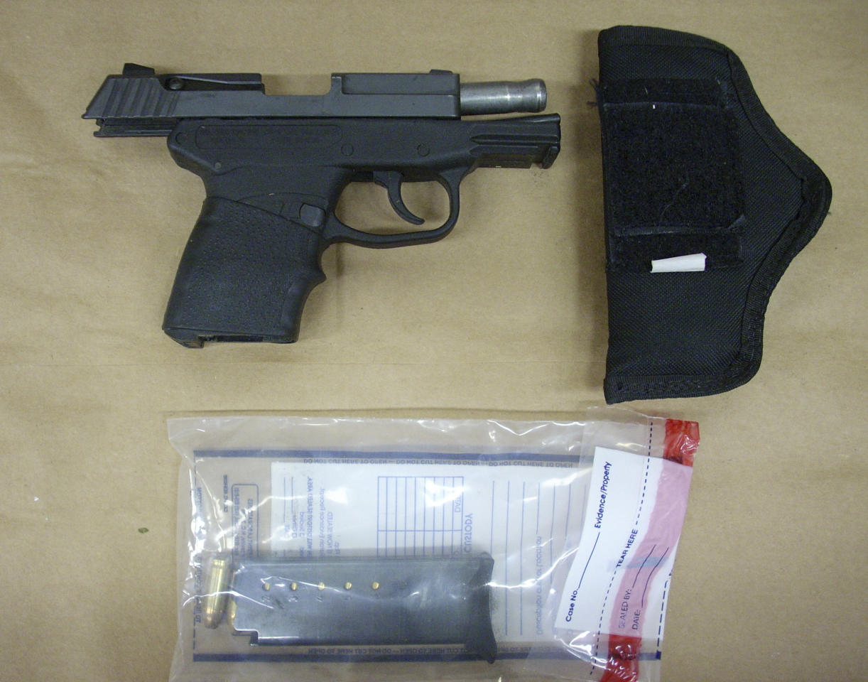 This Feb. 27, 2012 photo released by the State Attorney's Office shows the Kel-Tec PF-9 9mm handgun used by George Zimmerman, the neighborhoodwatch volunteer who shot Trayvon Martin. The photo and reports were among evidence released by prosecutors that also includes calls to police, video and numerous other documents. The package was received by defense lawyers earlier this week and released to the media on Thursday, May 17, 2012. (AP Photo/State Attorney's Office)
