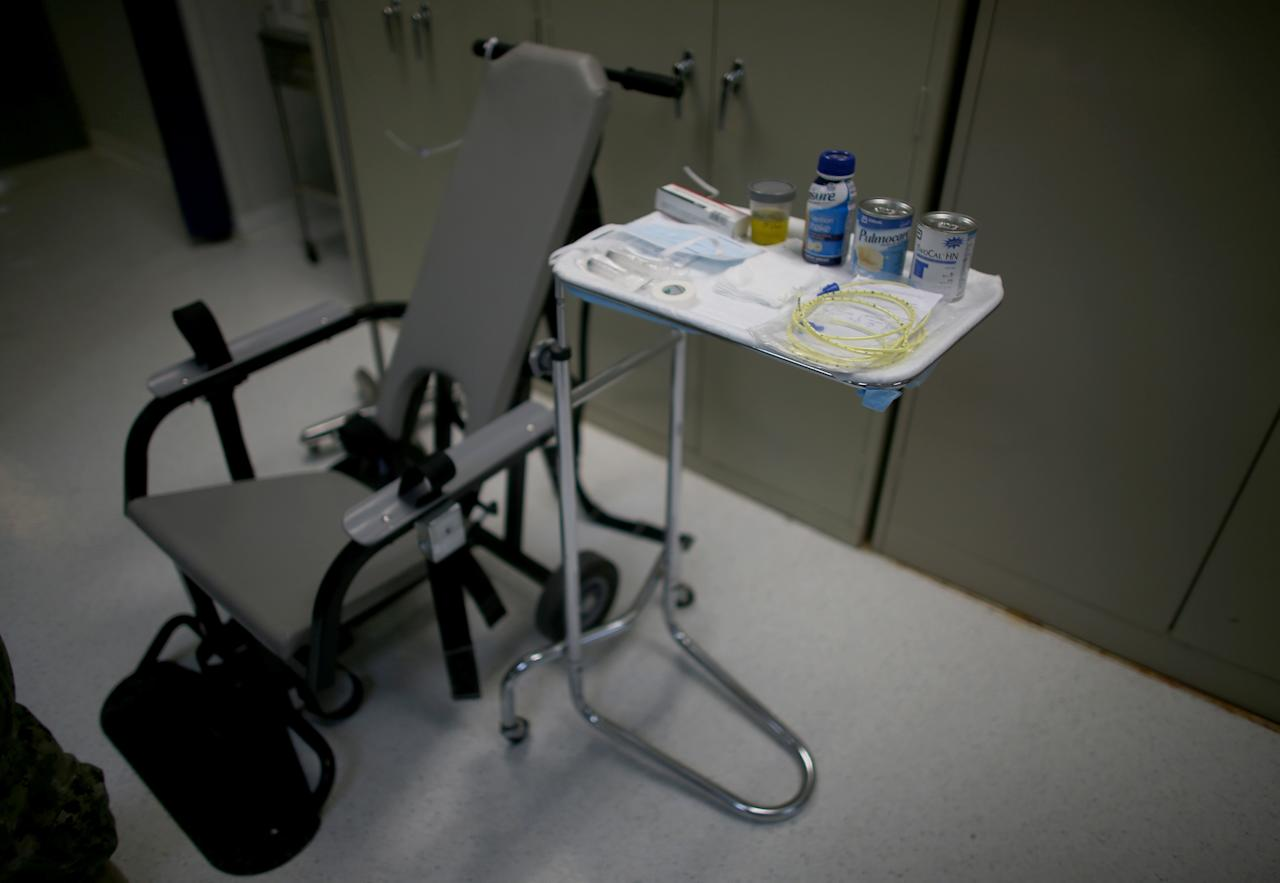 GUANTANAMO BAY, CUBA - JUNE 26: (EDITORS NOTE: Image has been reviewed by the U.S. Military prior to transmission.) The restraint chair used to force-feed detainees on hunger strike is seen at the detainee hospital in Camp Delta which is part of the U.S. military prison for 'enemy combatants' on June 26, 2013 in Guantanamo Bay, Cuba. President Barack Obama has recently spoken again about closing the prison which has been used to hold prisoners from the invasion of Afghanistan and the war on terror since early 2002. (Photo by Joe Raedle/Getty Images)
