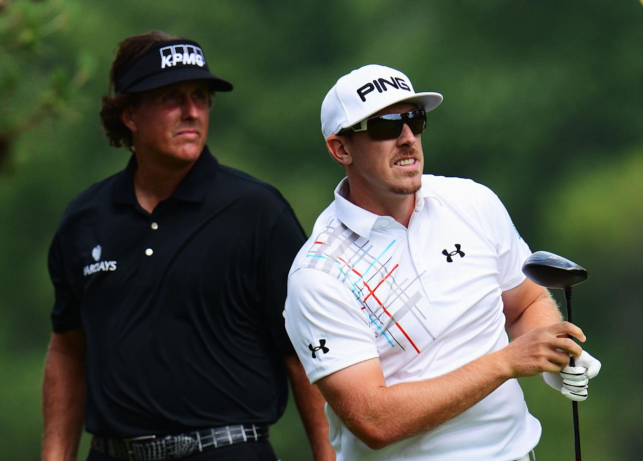 ARDMORE, PA - JUNE 16: (L-R) Phil Mickelson of the United States and Hunter Mahan of the United States look on from the second tee during the final round of the 113th U.S. Open at Merion Golf Club on June 16, 2013 in Ardmore, Pennsylvania.  (Photo by David Cannon/Getty Images)