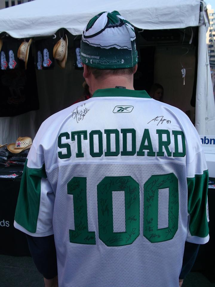 Trevor Stoddard shows off the back of his Riders jersey