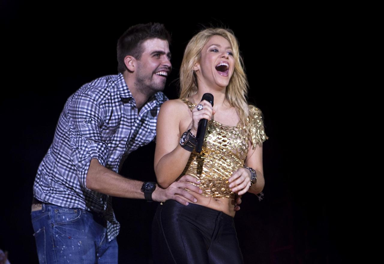 FILE - This May 29, 2011 file photo shows Colombia's singer Shakira performing with FC Barcelona soccer player Gerard Pique during The Sun Comes Out World Tour concert in Barcelona, Spain. UNICEF is hosting an online baby shower on Wednesday, Jan. 16, 2013 in honor of Shakira and Pique's first baby. Shakira, a UNICEF Goodwill Ambassador, and Pique are inviting people to donate to poor children worldwide through the online event. (AP Photo/Emilio Morenatti, File)